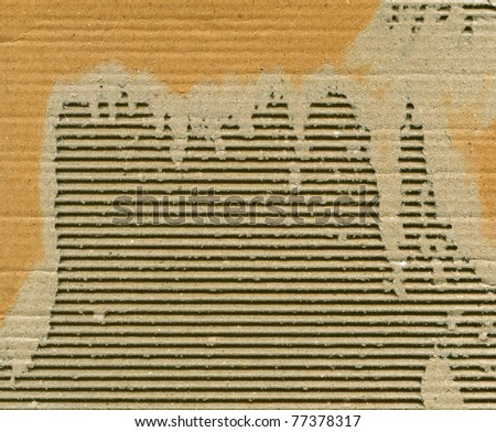 Textured recycled torn cardboard with natural fiber parts - stock photo