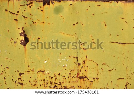 Textured rusty metal weathered and worn abstract background. - stock photo