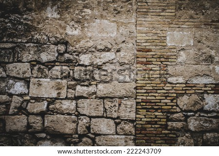 textured stone wall, Spanish city of Valencia, Mediterranean architecture - stock photo