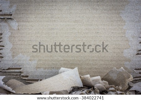 Textured torn corrugated striped cardboard with natural fiber parts. - stock photo