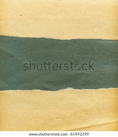 Textured torn obsolete paper with natural fiber parts - stock photo