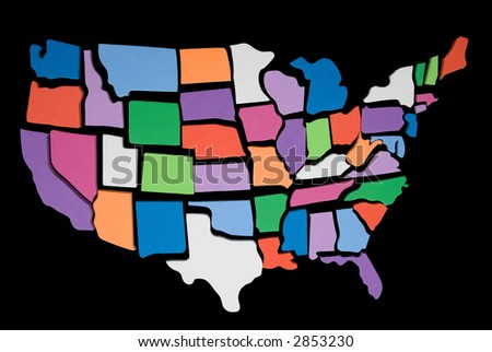 textured USA map puzzle outline over a black background - stock photo
