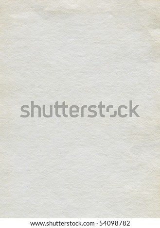 Textured white grainy recycled paper with natural fiber parts - stock photo