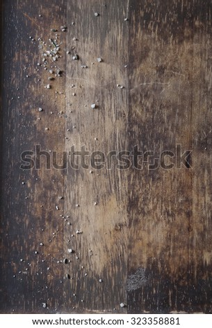 Textured Wood Board with Salt Crystals - stock photo