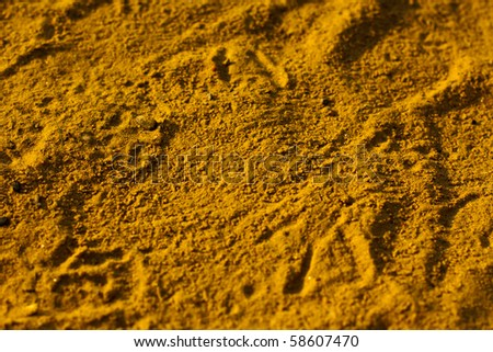 textured yellow sand in summer - stock photo