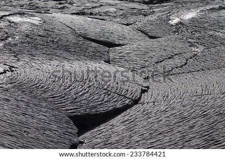 Textures of black lava (pahoehoe) in Santiago island - stock photo