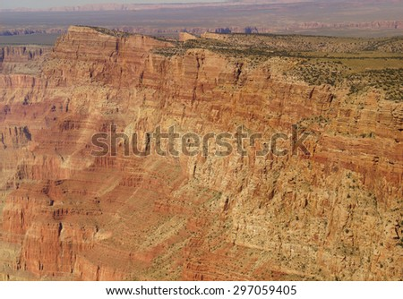 Textures of steep sandstone cliffs along the Rim Trail South Rim, Grand Canyon National Park, Arizona - stock photo