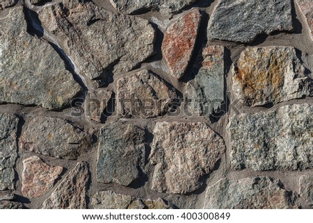 Textures stone background old wall made of pieces of granite