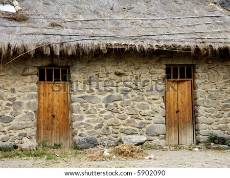 Thached House Wall Doors Village Peru - stock photo