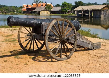 thai ancient cannon - stock photo