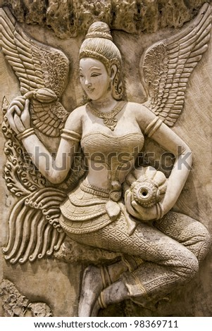 Thai ancient stone carving - stock photo