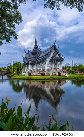 thai ancient temple with water reflection effect