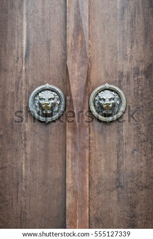 Thai Architectural detail : Old Teak Doors with Lion Head Brass Knobs
