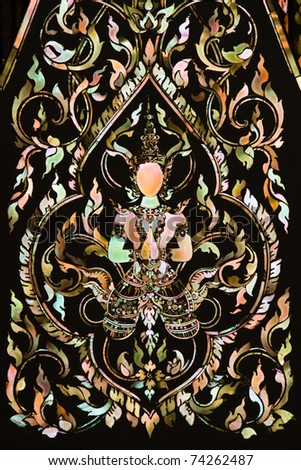 Thai art made from pearl on the  door of Rarchabophit temple Thailand. - stock photo