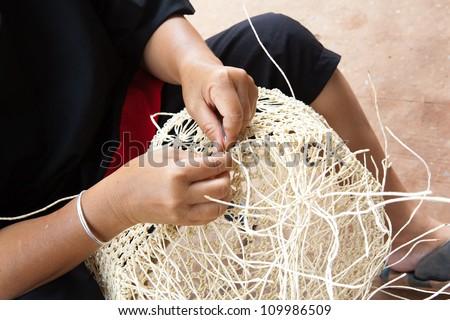 Thai artisan making basket - stock photo