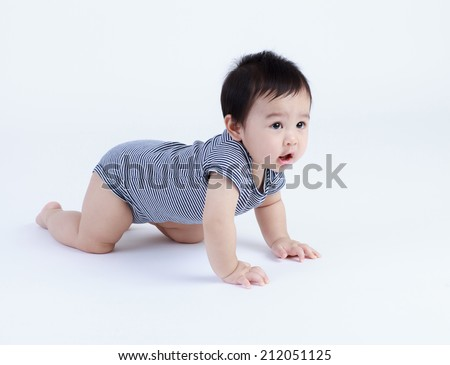 Thai baby crawling isolated  - stock photo