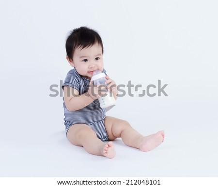 Thai baby drinking milk isolated   - stock photo