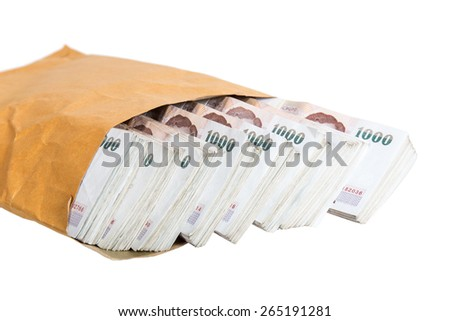 thai baht banknotes in brown envelope isolated on white