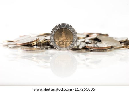 Thai baht coins, 10 baht coin with reflection isolated on white background - stock photo