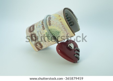 Thai baht currency notes with lock and chain. money stack for safety. - stock photo