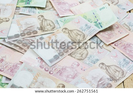 Thai baht note display as background - stock photo