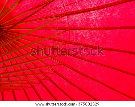 Thai bamboo wood handmade design inside red umbrella in Chiang Mai