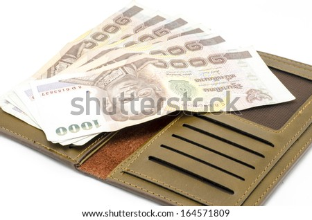 thai banknote in brown wallet isolated on white background