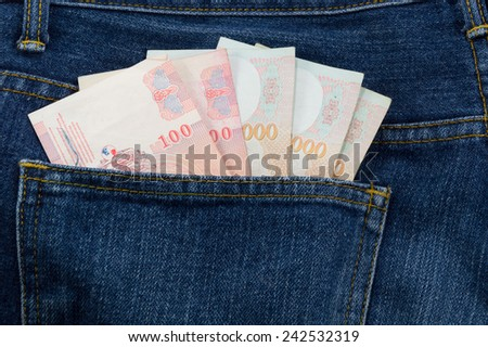 thai banknotes in jeans pocket