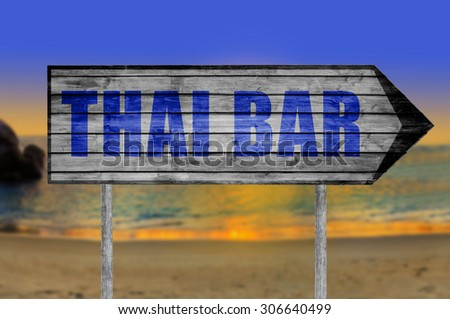 Thai Bar wooden sign with on a beach background - stock photo