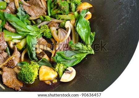 Thai basil beef in a wok pan - stock photo