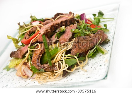 Thai beef salad with peppers and noodles - stock photo