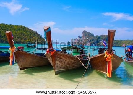 Thai boat in the bay - stock photo
