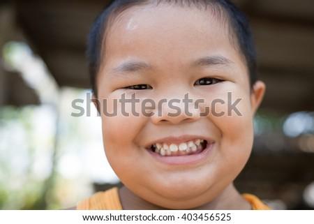 Thai boy's smiling happily. - stock photo