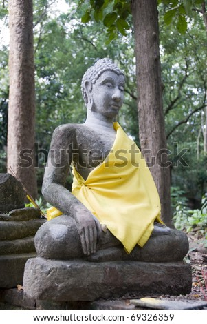 Thai Buddha sitting in forest - stock photo