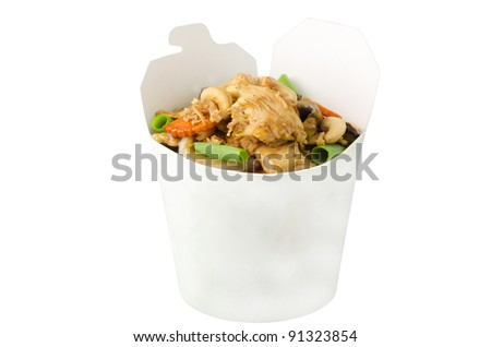 Thai chicken cashew nuts  in takeaway box. - stock photo