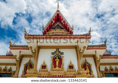 Thai church with beautiful sky, Thailand any kind of art decorated in Buddhist matter. Created with money of people to hire artist. They are public domain or treasure of Buddhism, no restrict in use. - stock photo