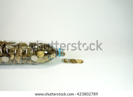 Thai coins in big recycle bottle isolated on white background