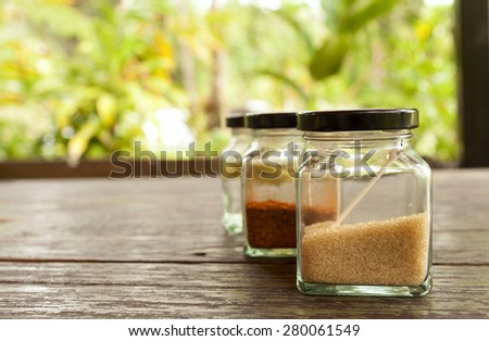 Thai condiment set in the glass bottle with space on nature background - stock photo