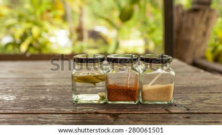 Thai condiment set in the glass bottle with space on the background - stock photo