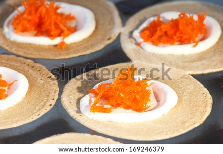 thai crispy pancake cooking with cream and coconut sweet - stock photo