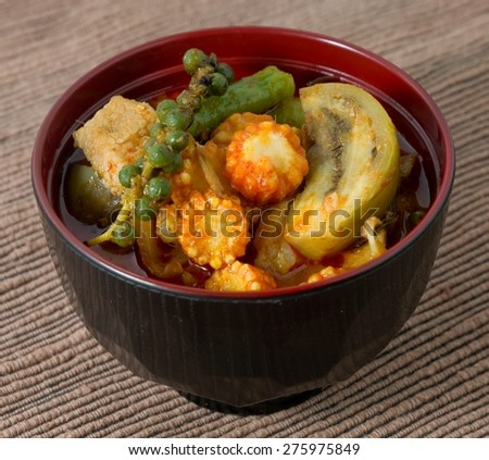 Thai Cuisine and Food, A Delicious Thai Spicy Red Curry with Pork, Baby Corn, Green Eggplant, Peppercorn, Cowpea and Coconut Milk.