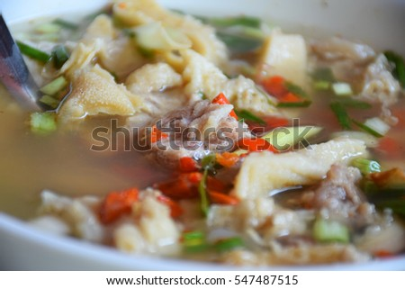 Thai Cuisine and Food. Delicious Thai Clear Spicy Hot and Sour Soup with Beef Entrails.