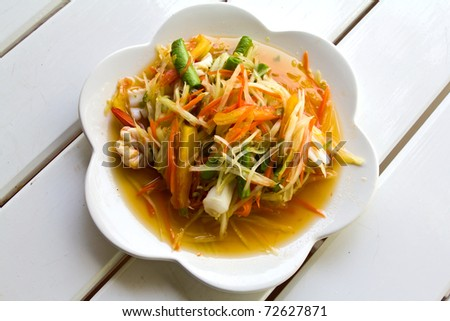 Thai cuisine - hot and spicy papaya salad - stock photo