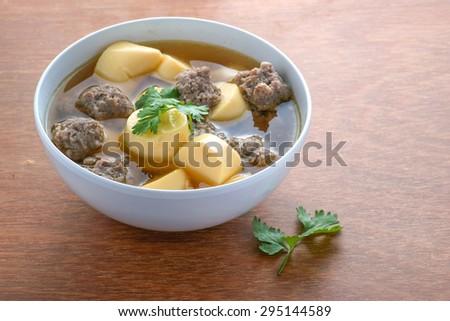 Thai Cuisine;Minced pork and soya bean curd soup on wood background - stock photo
