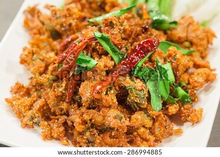 Thai cuisine spicy crispy pork salad, Larb - stock photo