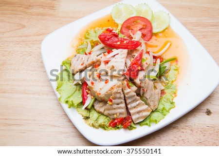 Thai cuisine spicy pork salad - stock photo