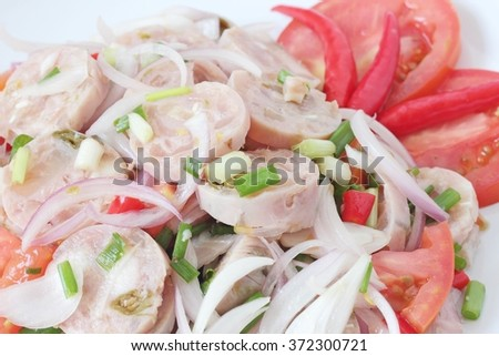 Thai Cuisine : Thai Sour Sausage or Thai Fermented Sausage Made With Pork, Pork Skins, Cooked Sticky Rice, Garlic, Salt, Sugar and Chilies. - stock photo