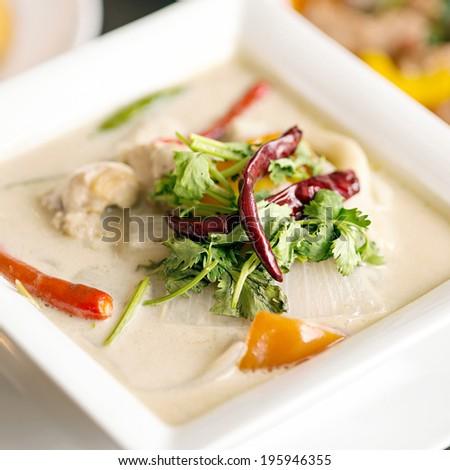 thai cuisine- tom kha kai -chicken in coconut milk soup - stock photo