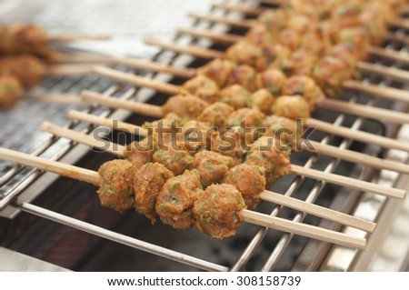 Thai curried fish cake grill on a barbecue, selective focus and soft focus - stock photo