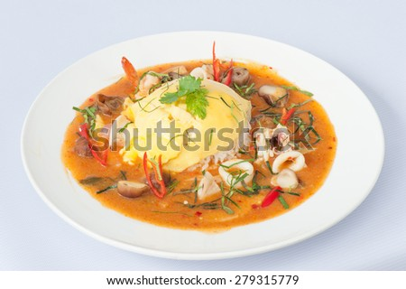 Thai Curry with Egg and Seafood Isolated on White Background - stock photo